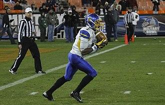Tyler Ervin - Ervin returns a kickoff during the 2012 Military Bowl.