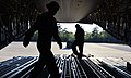 U.S. Air Force Senior Airman Sydney Lyda, left, and Staff Sgt. Robert Clark, both C-17 Globemaster III aircraft loadmasters with the 8th Airlift Squadron, prepare a ramp to load motorcycles at Hurlburt Field 130425-F-IO684-413.jpg