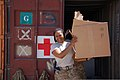 U.S. Army Master Sgt. Deidre Coley, with Combined Joint Interagency Task Force 435, carries boxes of donated items to be sorted for an Operation Outreach Afghanistan program at Camp Phoenix, Kabul province 130728-D-BO405-062.jpg