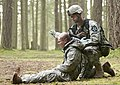 U.S. Army Sgt. Chris Swearingen a senior line medic with 2nd Battalion, 3rd Infantry Regiment, prepares to move a casualty as part of the training lane for the Expert Field Medic Badge at Joint Base 130409-A-CD114-139.jpg