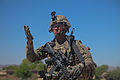 U.S. Army Sgt. Mark Kresge, with Baker Company, 1st Battalion, 506th Infantry Regiment, 4th Brigade Combat Team, 101st Airborne Division, signals his team to move ahead while clearing a village with Afghan 130529-A-CW939-010.jpg