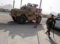 U.S. Army Spc. Wilson Berlin, a member of the Farah Provincial Reconstruction Team (PRT) security force, prepares to depart Forward Operating Base Farah for a mission in Farah city, Farah province, Afghanistan 120829-N-II659-203.jpg