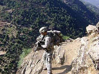Battle of Kamdesh - U.S. Army Staff Sgt. Clinton L. Romesha patrols near Combat Outpost Keating in Kamdesh, Nuristan province, Afghanistan, 27 July 2009.