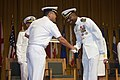 U.S. Navy Capt. Pius Aiyelawo, outgoing commander, U.S. Naval Hospital Okinawa, right, recieves a letter of appreciation from Rear Adm. Shigeaki Yanagida, Surgeon General and Director of Medicine, Japan Maritime 130718-M-DG262-038.jpg