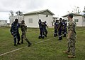 U.S. Navy Chief Petty Officer Charles M. Johnson, right, a Navy maritime interdiction operations team member, observes as Seychellois service members and members of the Eastern Africa Standby Force practice 131106-N-EZ054-053.jpg