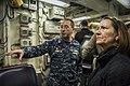 U.S. Navy Cmdr. Scott Jones, left, the commanding officer of the guided missile destroyer USS Donald Cook (DDG 75), discusses the ship's ballistic missile defense capabilities with Elaine Bunn, the deputy 140109-N-KE519-165.jpg