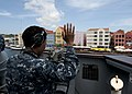 U.S. Navy Quartermaster 3rd Class Kaiser Chowdhury waves to people on shore as the guided missile frigate USS Underwood (FFG 36) leaves Willemstad, Curacao, during Southern Seas 2012 Aug. 31, 2012 120831-N-NL541-058.jpg