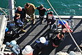 U.S. Sailors assigned to MCM Crew Dominant and deployed aboard the mine countermeasures ship USS Gladiator (MCM 11), along with Sailors with Explosive Ordnance Disposal Mobile Unit 6 and contractors attend 130117-N-CG436-006.jpg