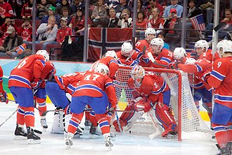 Norway men's national ice hockey team - Norwegian players prior to a game during the 2010 Winter Olympics, where they finished in 12th place.