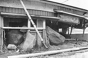 Mount Unzen - House destroyed and partially buried by lahars in the Mizunashi River valley, 1994
