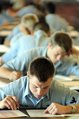 US Navy 030313-N-3228G-002 Nearly 250 candidates for E-5 mark their answer sheets while taking the March 2003 advancement exam at the Club Pearl Complex