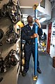US Navy 030407-N-4953E-085 Damage Controlman 3rd Class Quan Martinear performs preventive maintenance on metal shoring aboard USS Harry S. Truman (CVN 75).jpg