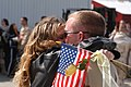 US Navy 030430-N-6901L-002 Cryptologic Technician 2nd Class Jeff Hansen from Bellingham, Wash. kisses his girlfriend after returning home from deployment.jpg