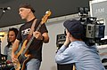 US Navy 040615-N-7217H-062 Journalist Allaman Smith assigned to the Naval Media Center Sasebo, records rock group Dishwalla's bass player, Scot Alexander.jpg