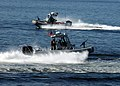US Navy 050804-N-3931M-034 Sailors assigned to Mobile Security Squadron Three (MSS-3), Detachment 32, patrol the downtown Seattle waterfront as a visual deterrent.jpg