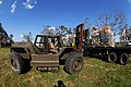 US Navy 050909-N-5526M-001 U.S. Navy Seabee's assigned to Naval Mobile Construction Battalion Four Zero (NMCB-40) unload equipment to be used in support of relief efforts from hurricane Katrina.jpg