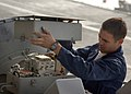 US Navy 051118-N-7241L-005 Electronics Technician Third Class Urban Garcia of San Diego, Calif., performs maintenance on the AN-SPN-46 Precision Approach Radar system aboard USS Theodore Roosevelt (CVN 71).jpg