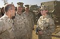 US Navy 051123-F-9927R-013 Commander, Disaster Assistance Center – Pakistan, U.S. Navy Rear Adm. Mike Lefever, speaks with U.S. Navy Lt. Kimberly N. Livingston, about the conditions of the patients.jpg