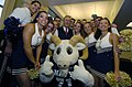 US Navy 051130-N-9693M-011 Secretary of Defense Donald Rumsfeld poses for a photograph with the U.S. Naval Academy cheerleader squad during a Pep-Rally.jpg