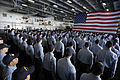 US Navy 051202-N-9389D-096 Recently selected first, second and third class petty officers stand at attention during their frocking ceremony held in the hangar bay aboard the conventionally powered aircraft carrier USS Kitty Haw.jpg