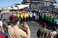 US Navy 060212-N-5961C-002 Commander, Carrier Strike Group Seven (CVW-7), Rear Adm. Michael H. Miller, conducts the oath re-enlistment aboard the Nimitz-class aircraft carrier USS Ronald Reagan (CVN 76).jpg