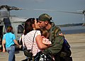 US Navy 060310-N-6936D-006 Aviation Warfare Systems Operator 2nd Class Nick Hoffman greets his wife and daughter after returning to Naval Air Station Jacksonville.jpg