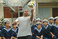 US Navy 060702-N-4124C-035 Storekeeper 1st Class Michael Simmons, assigned to the mine countermeasures ship USS Patriot (MCM 7), serves a volleyball.jpg