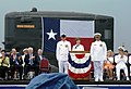US Navy 060909-N-0653J-005 Accompanied by Command Master Chief Mark Brooks, center-left, and Commanding Officer John J. Litherland, center-right, First Lady Laura Bush, delivers her remarks.jpg