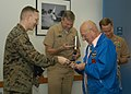 US Navy 070111-N-2789G-003 Lt. Col. James Dillon, commanding officer, Marine Corps Security Force Company (MCSFCo) Bangor, gives Bud Hawk, WWII Medal of Honor recipient, a MCSFCo Bangor command coin at Naval Base Kitsap Bangor.jpg