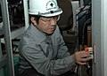 US Navy 070216-N-2970T-001 Safety Inspector Hirofumi Tokunaga conducts an open ground test on an electrical outlet.jpg