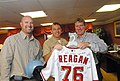 US Navy 070501-N-7730P-040 In the captain's in-port cabin on board USS Ronald Reagan (CVN 76), players from the Washington Nationals baseball team present a game jersey with Reagan's name and hull number.jpg
