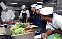 US Navy 070714-N-9150R-055 Culinary specialists watch as Executive Chef James Koskiniemi demonstrates his knife-handling skills aboard amphibious assault ship USS Boxer (LHD 4).jpg