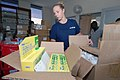 US Navy 070905-N-8704K-028 U.S. Coast Guard Health Services Technician 2nd Class Janelle Smith, attached to Military Sealift Command hospital ship USNS Comfort (T-AH 20), stocks a pharmacy at Hôpital Universitaire de la Paix.jpg