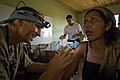 US Navy 080820-N-9620B-009 Lt. Cmdr. Nathan Upbelhoer examines an abnormal irritation on a local Nicaraguan woman.jpg