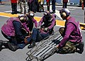 US Navy 080915-N-8132M-100 Sailors assigned to the stretcher bearer team simulate recovering an injured Sailor.jpg