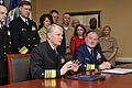US Navy 090401-N-8273J-023 Chief of Naval Operations (CNO) Adm. Gary Roughead, left, delivers remarks as Commandant of the Coast Guard Adm. Thad W. Allen looks on after the signing of a memorandum of agreement for the Safe Harb.jpg