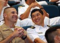 US Navy 090608-N-8467B-027 Maj. Derek Snell, landing force officer-in-charge for Cooperation Afloat Readiness and Training (CARAT) 2009, visits with Lt. Col. Vince Tan, executive officer of the Republic of Singapore Navy frigat.jpg