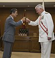 US Navy 090929-N-8623G-110 Adm. Timothy J. Keating, commander of U.S. Pacific Command, and Japan Minister of Defense the Honorable Toshimi Kitazwa toast after Keating is presented with the Grand Cordon of the Order of the Risin.jpg