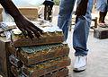 US Navy 100209-N-1092P-069 A volunteer from Mouvman Fanm Aktif Kafou (MOFKA), a female-led community-support organization, distributes goods supplied by the Maritime Civil Affairs Team to Haitian families.jpg