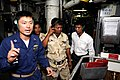US Navy 100218-N-8335D-013 Lt. Sung Choi gives Royal Cambodian navy officers Lt. Cmdr. Chea Korm and Lt. Cmdr. Im Saroeun a tour of the auxiliary machinery room of USS Patriot (MCM 7).jpg