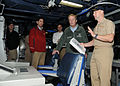 US Navy 100220-N-2259P-031 Capt. James J. Housinger, commanding officer of the guided-missile cruiser USS Mobile Bay (CG 53), explains the command information center to U.S. Congressman Todd Akin during a shipboard tour.jpg