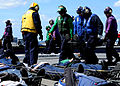 US Navy 100304-N-4408B-026 Sailors carry stokes stretchers to one of the ship's aircraft elevators during a mass casualty drill.jpg