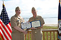 US Navy 100318-N-6936D-042 Rear Adm. Tim Alexander, commander of Navy Region Southeast, presents the Bronze Star medal to Lt. Stephen Wangelin.jpg