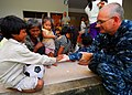 US Navy 100623-N-4044H-098 A Cambodian child gives a high-five to Lt. Derrick Horne, a Navy chaplain embarked aboard the Military Sealift Command hospital ship USNS Mercy (T-AH 19), during a community service event.jpg
