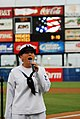US Navy 100813-N-2686K-063 Musician 3rd Class Sarah Janiak sings the national anthem during the 2nd annual Navy Night at Harbor Park.jpg