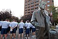 US Navy 100816-N-6676S-023 Chief petty officer (CPO) selectees listen to a tour guide explain the history of The Lone Sailor statue.jpg