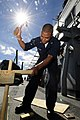 US Navy 101024-N-8913A-096 Gunner's Mate 3rd Class Charles A. Taylor hammers wood in place for shooting targets on the weather deck aboard the guid.jpg
