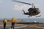 US Navy 110216-N-4743B-095 Sailors direct a Royal Thai Navy Bell 212 helicopter aboard USS Essex (LHD 2)