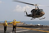 US Navy 110216-N-4743B-095 Sailors direct a Royal Thai Navy Bell 212 helicopter aboard USS Essex (LHD 2).jpg