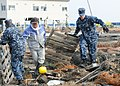 US Navy 110314-N-MU720-059 Chief Naval Air Crewmen Kyle Wilkinson, right, from Baldwinsville, N.Y., assigned to Naval Air Facility Misawa, helps re.jpg